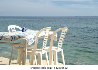 Plastic furniture in the cafe on the beach. Shooting in Cyprus.