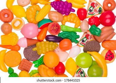 Plastic game, fake varied vegetables and fruits. background