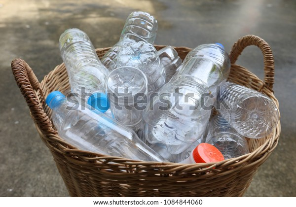 Plastic garbage bottles in bamboo basket recycle concept