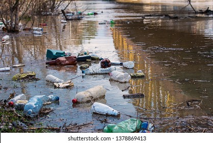 Plastic garbage in the river , pollution and environment concept