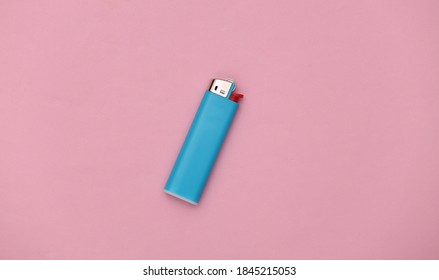 Plastic gas lighter on pink background. Top view. Minimalism - Shutterstock ID 1845215053