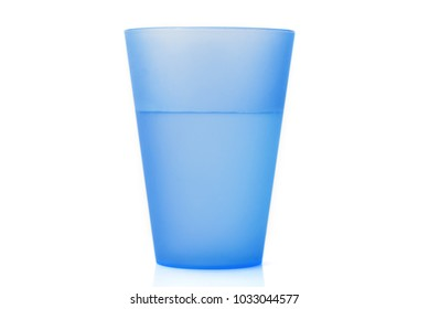 Plastic glass. Plastic cup with water on white background.