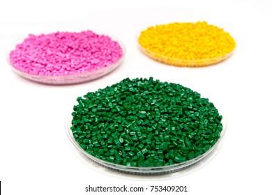 The plastic granules. Dye for polypropylene, polystyrene granules into a measuring container. Polyethylene  granules