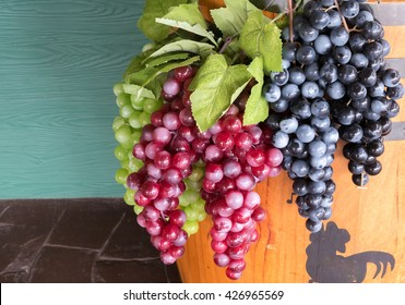 Plastic grape fruit, decorated with accessory background