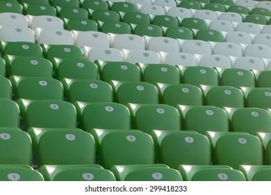 plastic green and white seats on football stadium