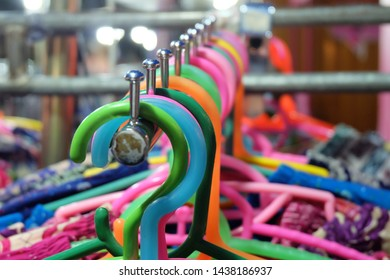 Plastic hanger for clothes at the local night market.
