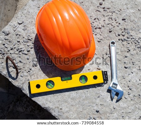 9f5279a2a0b Plastic hard hat spirit level (bubble level) and adjustable spanner (adjustable  wrench