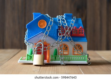 plastic house model  lockdown with chain and padlock