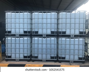 Plastic IBC Tank storing liquid chemical stacked on each other.