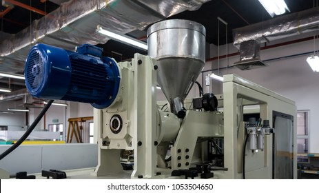 Plastic injection molding machine in a modern hi-tech factory.
