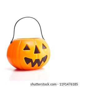 Plastic jack-o-lantern trick or treat on white background With empty space available for Text