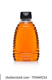 Plastic jar bottle with organic natural honey on white background