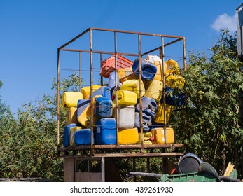 Plastic jerrycan  drums in color at the junkyard.
