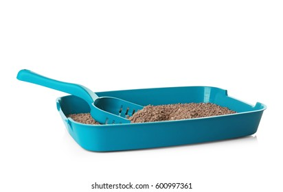 Plastic litter box with filler on white background
