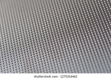 Plastic metalic dot pattern in grey silver colour. Abstract background of lots of grey pimples dots.