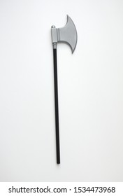 Plastic miniature model of pick axe with black handle. Toy ax isolated white background.