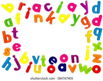 Plastic multicoloured plastic letters on a white background with copyspace