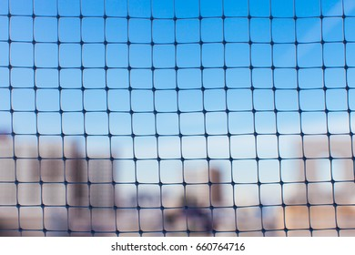 Plastic nylon net under the blue sky and building background