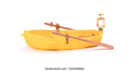 Plastic old small boat isolated on white background, toy