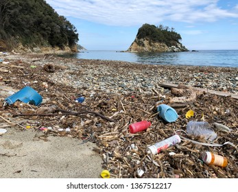 Plastic on the beach of the Pauline in Elba island. Pollution of the seas.