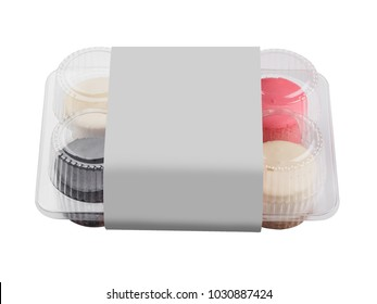 Plastic package with color round cheesecakes. white isolated background.