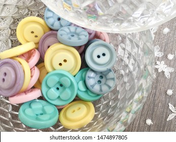 plastic pastel candy button in vintage glass jar