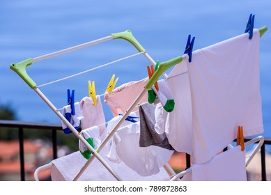 Plastic pegs on laundry grid at balcony.