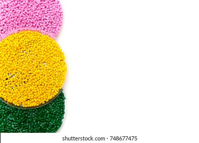 Plastic pellets green yellow and pink . Colorant for polymers in granules. Template