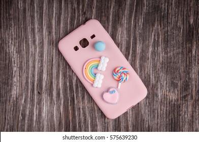 Plastic phone case on rustic wood