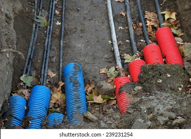 Plastic pipes containing electric cables in the ground