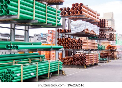 Plastic pipes stacked in a factory or warehouse yard for use in plumbing or sewage installations on a construction site