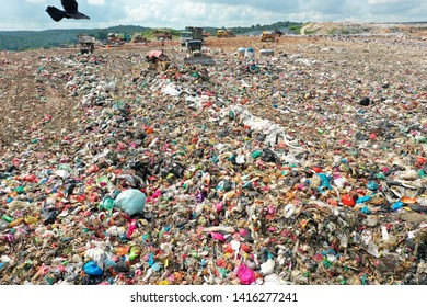 Plastic pollution crisis. Bulldozers on a landfill in Malaysia