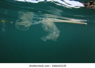 Plastic pollution environmental problem. Bags, bottles, straws and other garbage pollute the sea