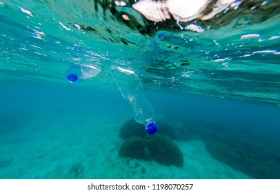 Plastic pollution in ocean. Drifting plastic bottles.