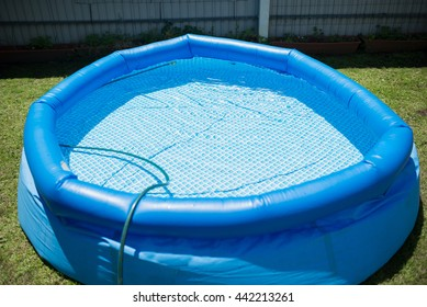 Plastic pool in a summer day outdoors