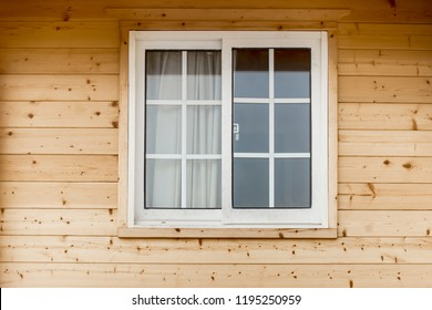Plastic PVC Window in New Modern Passive Wooden House Facade Wall. PVC Windows are the Number One in House Energy Efficiency