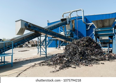 Plastic recycling facility/Plastic and rubber components resulted from cars disassembled are being shredded and separated during recycling process.