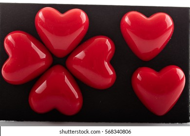Plastic red valentine hearts isolated