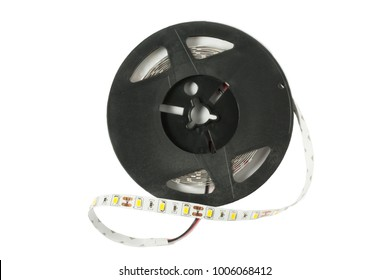 Plastic reel with LED strips for lighting the room.Led lights tape isolated on white background. Top view