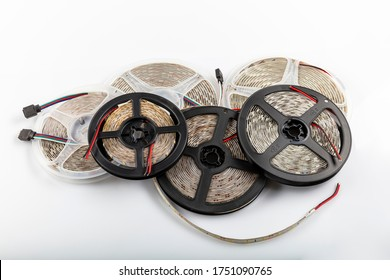 Plastic reel with LED strips for lighting the room.Led lights tape on white background.