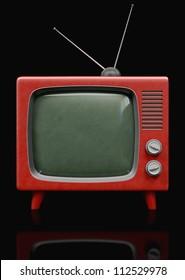 A Plastic retro Television on a black background