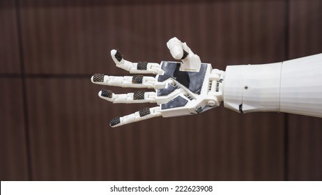 plastic robot hand with open palm gesture