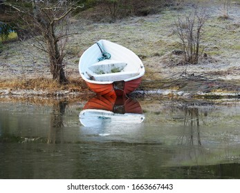 Plastic rowing boat pulled ashore