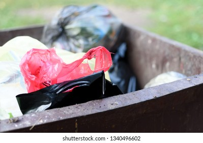 Plastic rubbish bags in a metal refuse bin awaiting collection as part of household waste