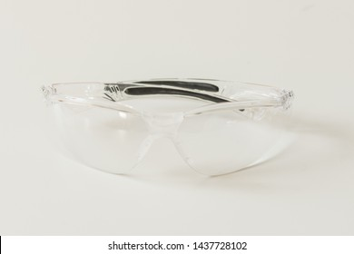 Plastic safety glasses on white background. Protective glasses on factory working.