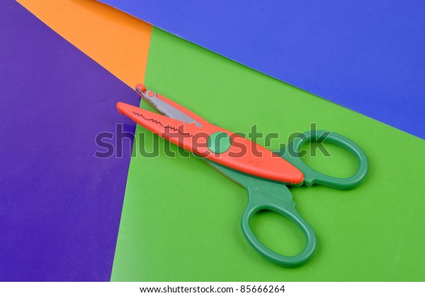 plastic scissors on colored papers