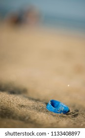 Plastic Screw cap of a bottle abandoned on a sandy beach.