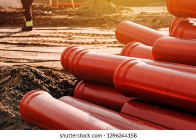 Plastic sewer pipes on construction site for system repairing stacked and ready to be installed
