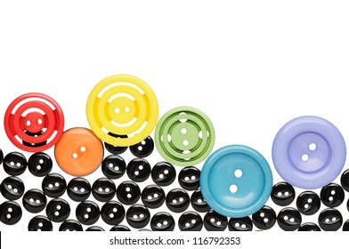 Plastic sewing buttons are arranged in a row. Isolated on white