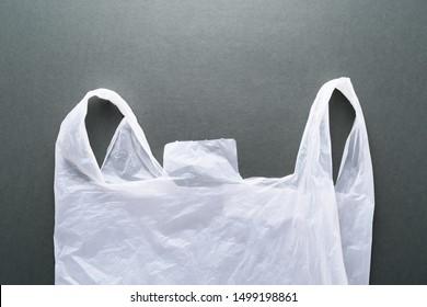 Plastic shopping bag on dark background. Waste of plastic bag.